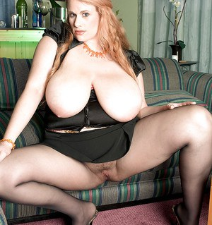 Pantyhose attired obese blonde Kore Goddess unleashing monster breasts