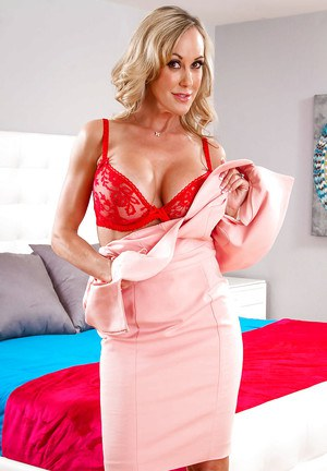 Blonde babe Brandi Love releasing big tits from lingerie while undressing