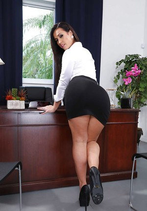 Brunette office babe Kelsi Monroe showing off phat secretary ass in office