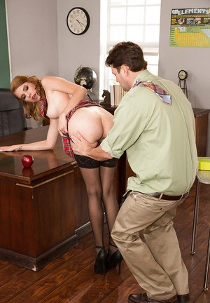 Stocking clad redhead coed CeCe Capella giving large cock a blowjob