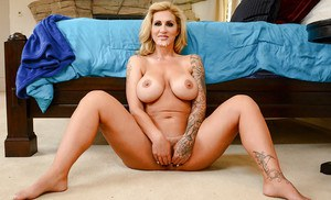 Tattooed blonde wife Ryan Conner baring large tits before fucking big cock