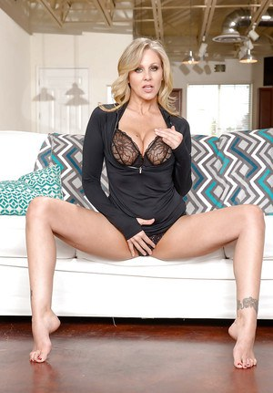 Leggy older blonde babe Julia Ann unleashing big tits from lingerie