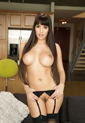 Leggy Latina solo girl Mercedes Carrera flaunting large tits in stockings