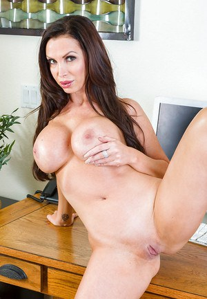 Amateur solo girl Nikki Benz displaying massive tits at work in office