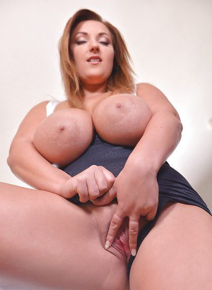 Big boobed solo girl Krystal Swift rids dress for spreading of shaved pussy