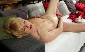 Experienced blonde lady in high heels and lingerie exposes tits and ass