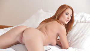 Redheaded European solo girl Eva Berger revealing tiny tits and phat ass