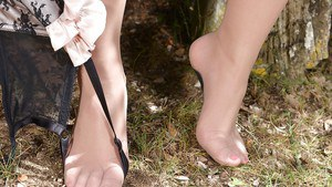 Hose attired brunette fatty Leanne Crow removes high heels outside in woods