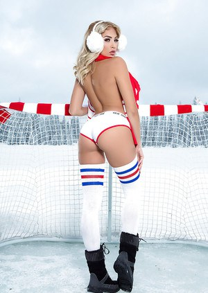 Centerfold babe in long socks and sports clothes modeling in boots