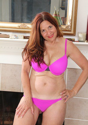 Chunky mature woman Bobby Jackson stripping off pantyhose in high heels