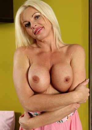 Aged blonde babe Casey Szilvia freeing big boobs and spreading pussy