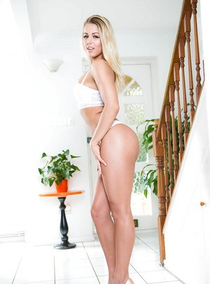 Blonde wife Christen Courtney revealing small MILF tits for solo girl shoot