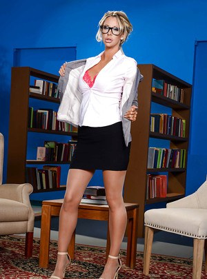 Glasses adorned blond babe Courtney Taylor exposing large MILF teacher tits