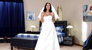 Solo girl Lylith Lavey letting large tits loose from wedding dress