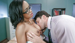 Busty glasses adorned black chick Anya Ivy giving and receiving oral sex