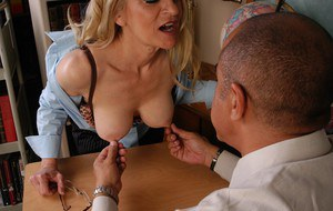 Mature stocking adorned teacher frees large tits for nipple play