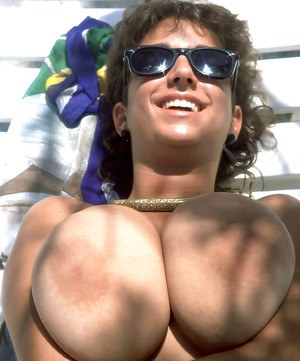 Mature beach babe Devon Daniels unleashing massive all natural melons