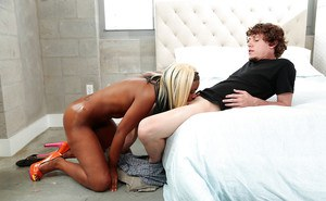 Blonde black girl Lucy Raquel giving big cock blowjob for cumshot on tits