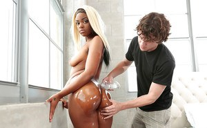 Ebony dime Lucy Raquel offering up oiled booty for hardcore fucking