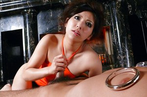 Asian brunette Kanade Otowa baring tiny tits while giving footjob