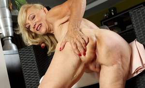 Mature blonde woman Janet Lesley revealing saggy tits and shaved vagina