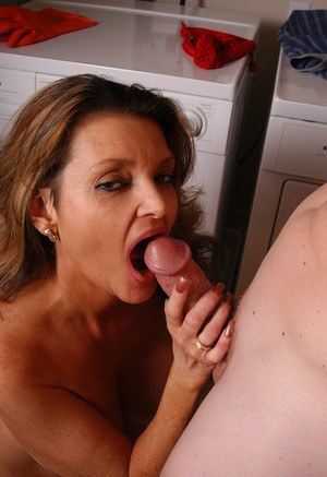 Older dame with large breasts taking cumshot after giving blowjob