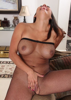 Busty mature Latina Abby Melon revealing shaved pussy in mesh bodystocking