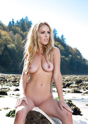 Blonde beach babe Heidi Michel flaunting perfect tits for centerfold shoot