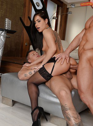 Stocking and garter clad brunette with tattoos taking DP in hardcore 3some