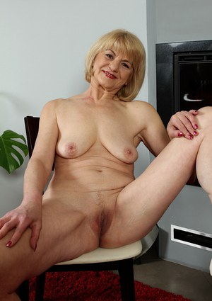 Aged blonde broad unveils small breasts and freshly shaved vagina