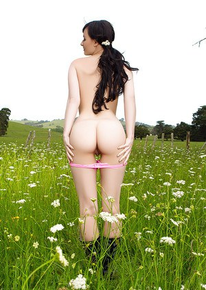 European centerfold babe Skylar Leigh modeling outdoors in rubber boots