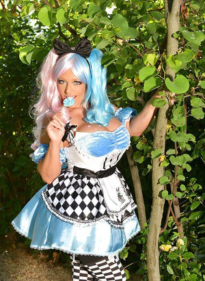 Cosplay attired solo girl Delzangel revealing large tits outdoors