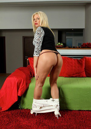 Leggy older Euro lady Casey Szilvia unveiling big tits in high heels