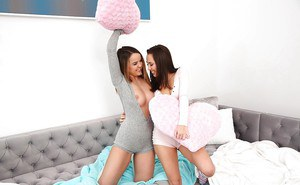 Lesbian pornstars Dillion Harper and Jenna Sativa fingering twats in socks