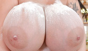 Overweight Euro chick Leanne Crow releasing massive melons in kitchen