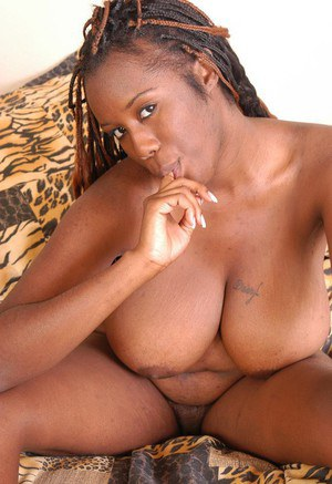 Chubby black chick bares big mature tits and ass before spreading beaver