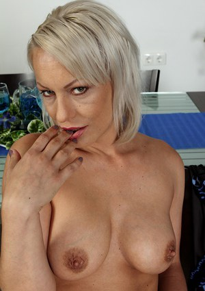 Busty aged blond lady Vanessa Moore playing with nipples while masturbating
