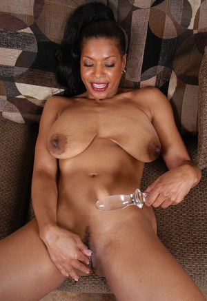 Mature black lady Semmie freeing huge saggy tits from bikini top