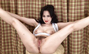Mature brunette dame unveils big natural tits and hairy snatch