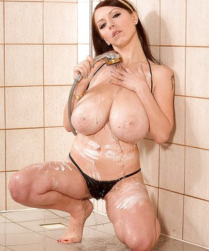 Solo girl Merilyn Sakova unleashing huge boobs and tattoos in shower