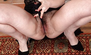 Older brunette lady slipping off lace panties to reveal hairy cooter