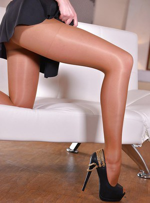 Euro babe Ivana Sugar displaying sexy legs and ass in pantyhose