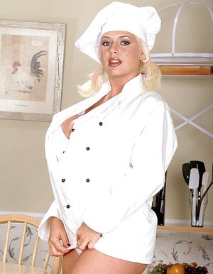 Chubby aged pornstar SaRenna Lee exposing massive hooters in kitchen