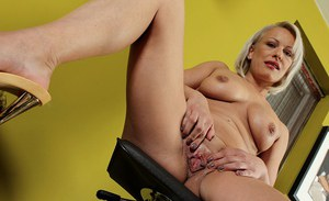 Busty mature blonde Vanessa Moore showing off nice ass and pink pussy