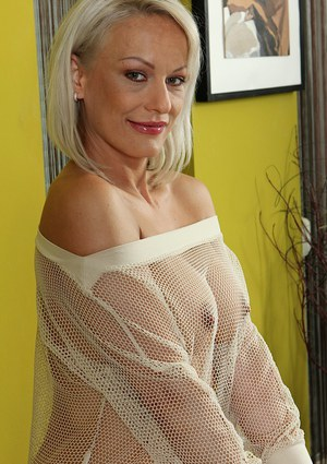 Older blonde lady Vanessa Moore exposing big tits and shaved pussy
