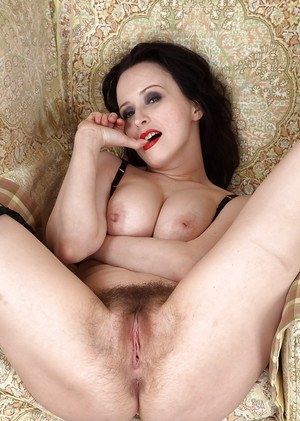 Mature brunette woman with really hairy pussy flaunting big natural tits