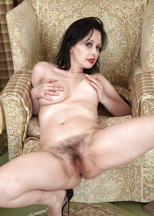 Older brunette lady in high heels revealing extremely hairy pussy