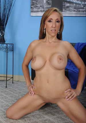 Solo girl Missy Bella frees big MILF boobs and nice ass from underthings