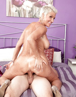 Busty short haired mature woman Lexy Cougar sporting hardcore creampie cum