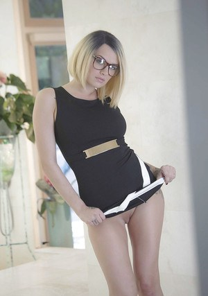 Inked babe in glasses revealing shaved pussy after shedding dress